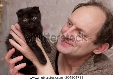 Happy man with little cat