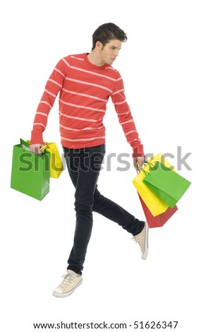 Happy man with shopping bag run - stock photo