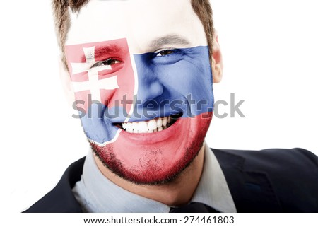 Happy man with Slovakia flag painted on face.
