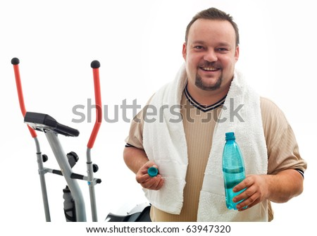 Happy man with water bottle after exercising on a trainer device - isolated, closeup - stock photo