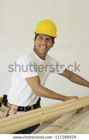 Happy man working at a construction site - stock photo