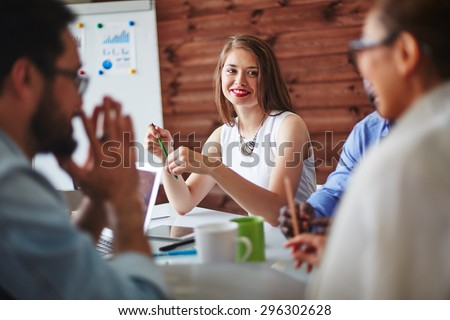 Happy manager looking at colleague during conversation - stock photo