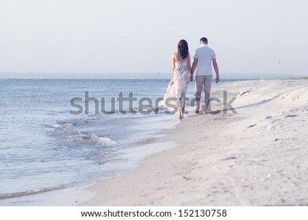 happy married adult couple on the sea shore. Horizontal shape, full length, copy space - stock photo