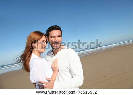Happy married couple at the beach - stock photo