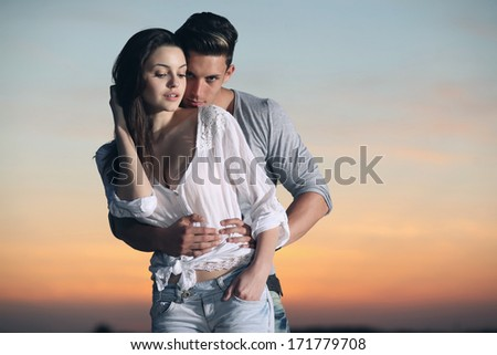 Happy married couple at the beach .Fashion colors. - stock photo