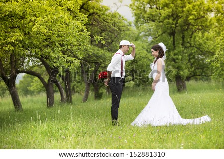 Happy married couple enjoying wedding day in nature