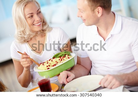 Happy married couple having dinner at home - stock photo