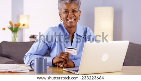 Happy Mature African woman approved with new credit card
