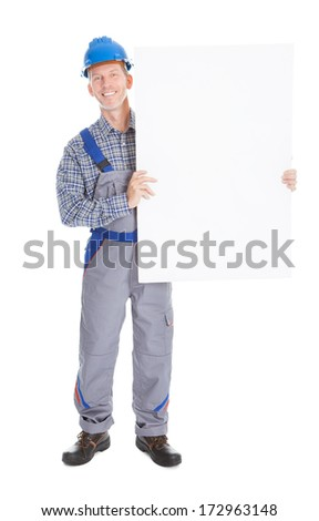 Happy Mature Architect Holding Placard On White Background - stock photo