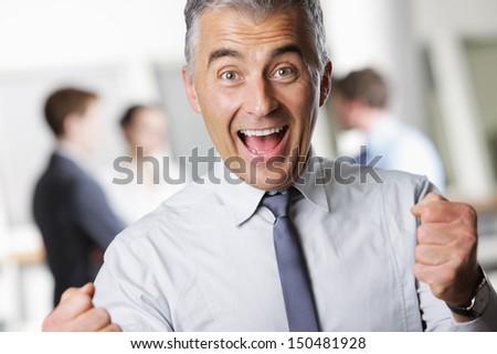 Happy mature business man celebrating his success - stock photo
