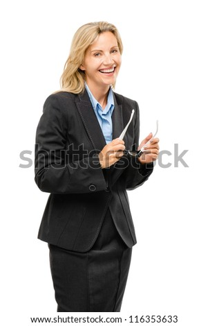 Happy mature business woman holding glasses isolated on white background