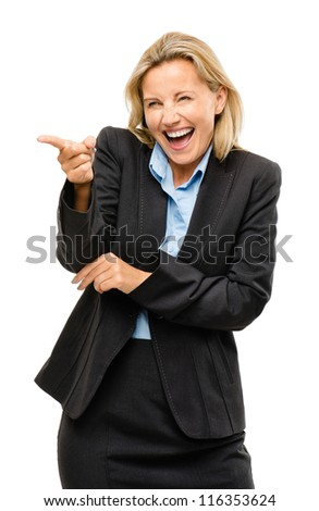 Happy mature business woman pointing laughing being silly isolated on white background