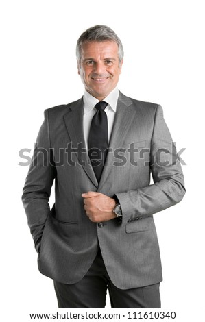 Happy mature businessman in suit looking at camera and smiling isolated on white background