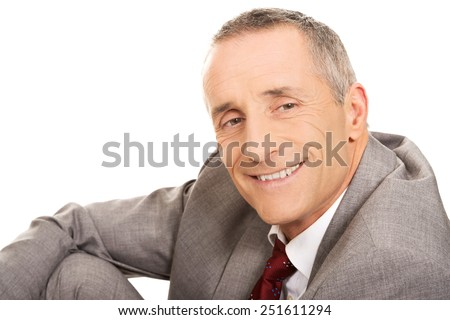 Happy mature businessman looking at camera. - stock photo