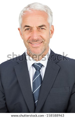Happy mature businessman looking at camera on white background