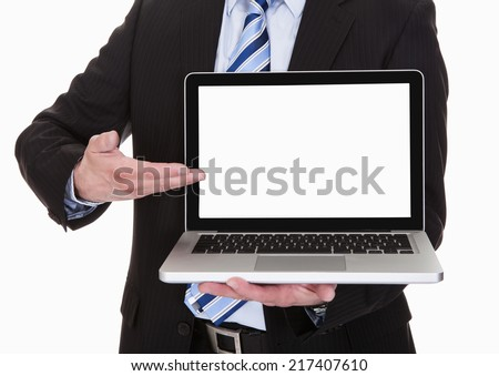 Happy Mature Businessman Pointing On Laptop Over White Background - stock photo