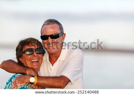Happy Mature Couple at the Beach