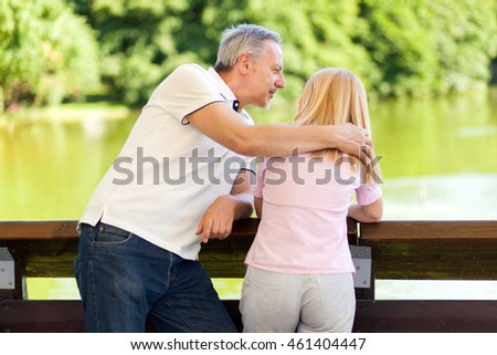 Happy mature couple at the park