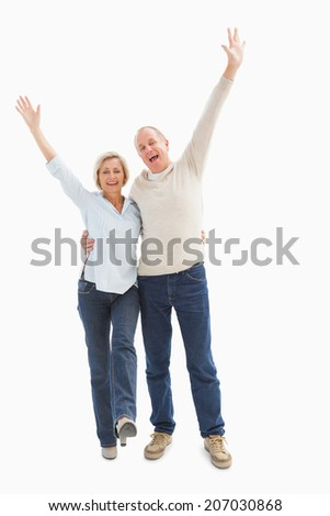 Happy mature couple cheering at camera on white background - stock photo