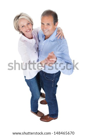 Happy Mature Couple Dancing Isolated Over White Background - stock photo