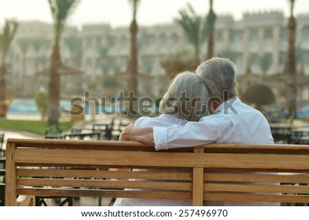 Happy Mature couple enjoy fresh air and stunning view on vacation - stock photo