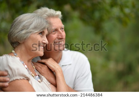 Happy mature couple faces in summer park