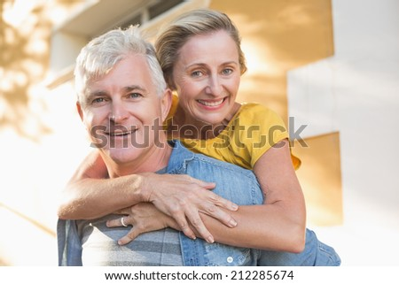 Happy mature couple having fun in the city on a sunny day - stock photo
