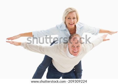 Happy mature couple having fun on white background - stock photo