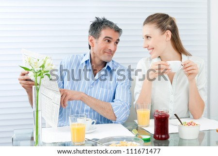 Happy mature couple having healthy breakfast.