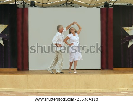 Happy Mature couple in love dancing - stock photo