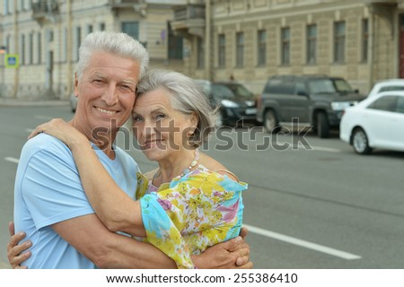 Happy Mature couple in town - stock photo