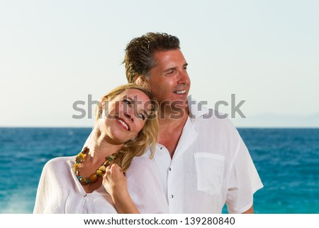 Happy mature couple on the beach