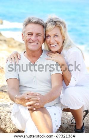 Happy mature couple outdoors. - stock photo