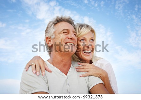 Happy mature couple outdoors. - stock photo