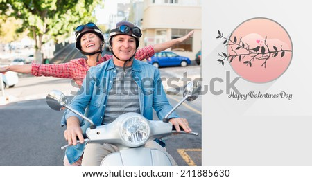 Happy mature couple riding a scooter in the city against love birds - stock photo