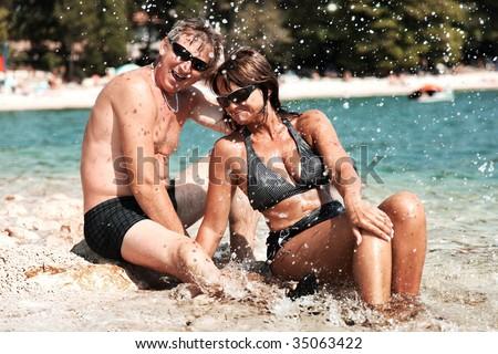 Happy mature couple smiling - stock photo