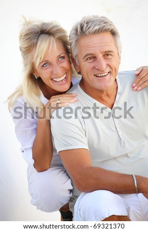 Happy mature couple smiling.