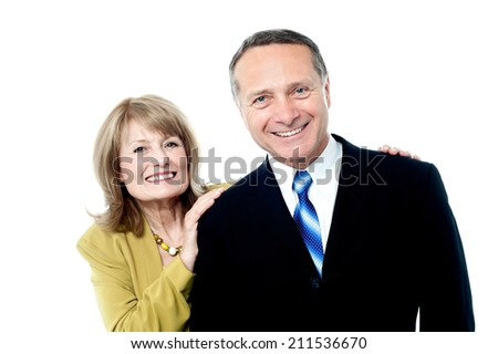 Happy mature couple smiling at camera - stock photo