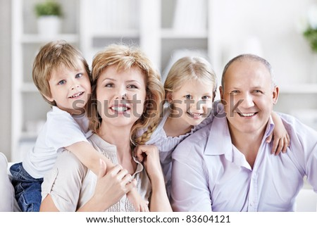 Happy mature couple with grandchildren - stock photo