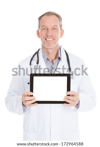 Happy Mature Doctor Showing Tablet Over White Background