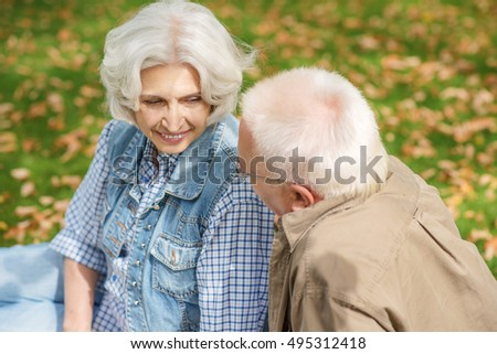 Happy mature man and woman relaxing in nature
