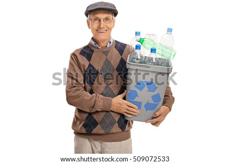 Happy mature man holding a recycling bin full of plastic bottles isolated on white background
