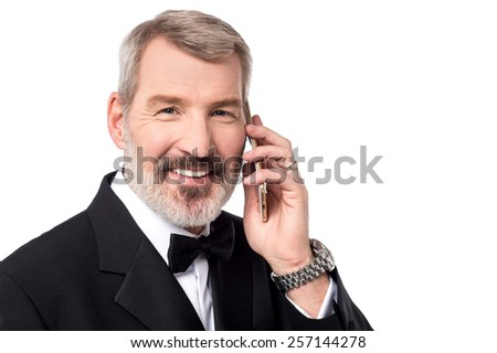 Happy mature man talking on his cell phone