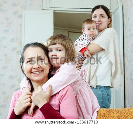 Happy mature woman and adult daughter with two children