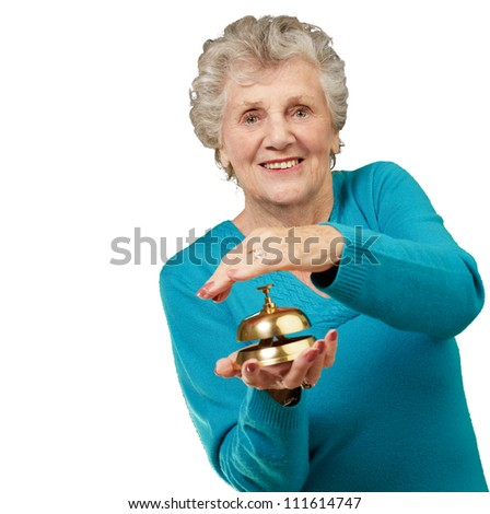 Happy Mature Woman While Holding Bell On White Background