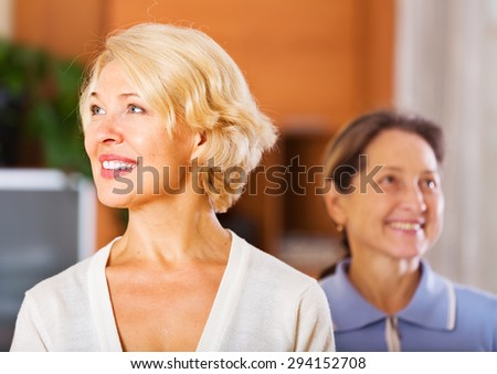Happy mature women posing at home - stock photo