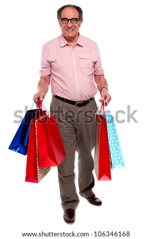 Happy Matured Man Carrying Shopping Bags Full Length Portrait