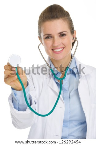 Happy medical doctor woman using stethoscope