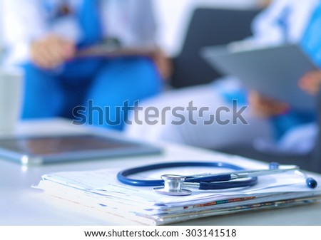 Happy medical team discussing and working together - stock photo