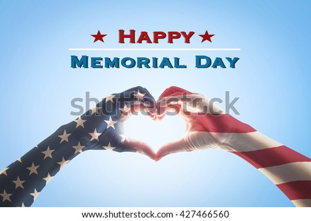 Happy memorial day text message with America flag pattern on people hands in heart shaped form isolated on blue sky background: United states of america USA labor day, US veterans day concept - stock photo